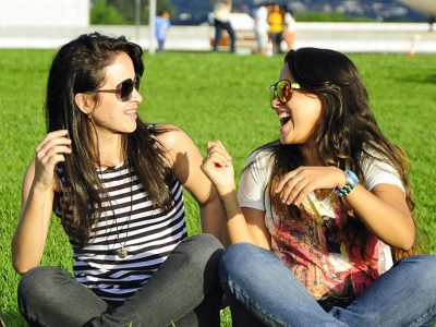 2 Girls Conversing in a Field