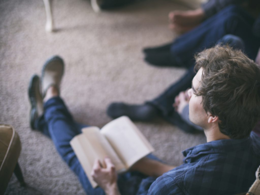 Man Sitting on Floor for Bible Study