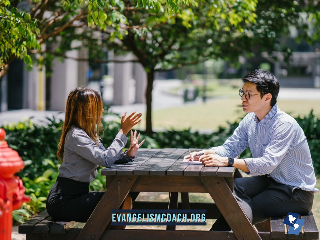 Two People Talking and Conversing about Jesus at a picnic table