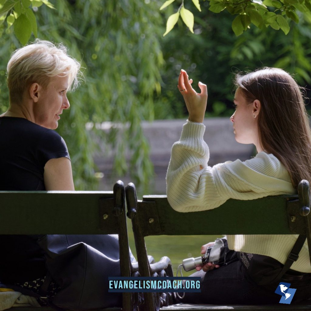 Two Women talk on park bench