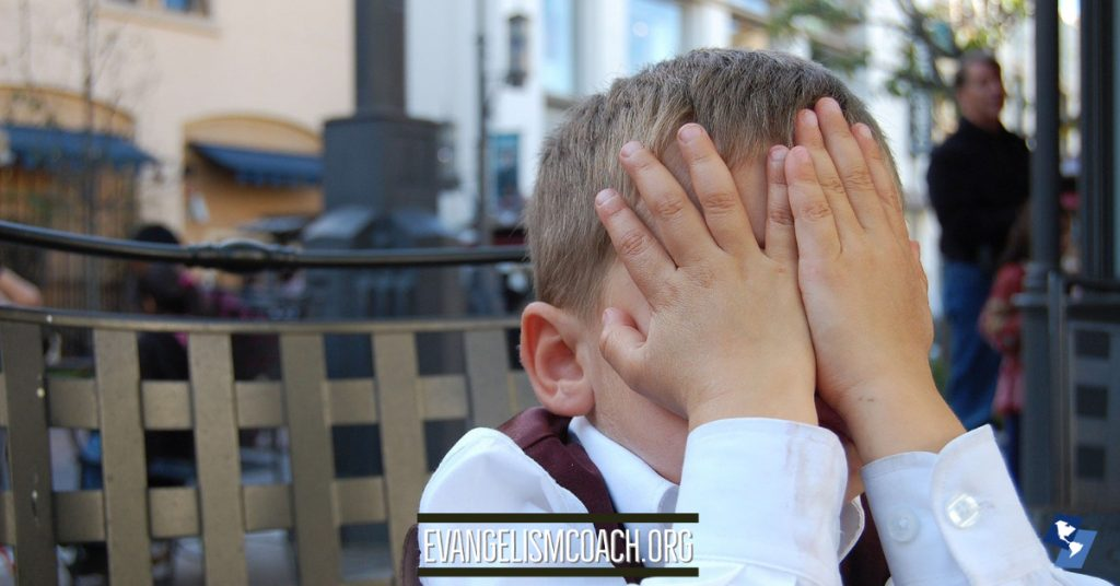 Facepalm hiding embarrassment at a gospel sharing failure