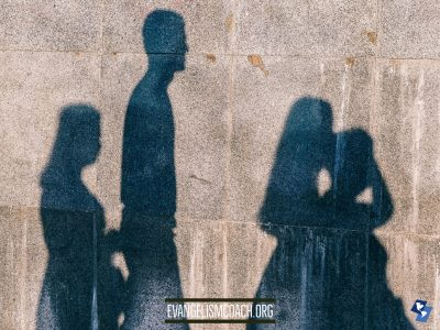 Shadow of a family on wall - anonymous