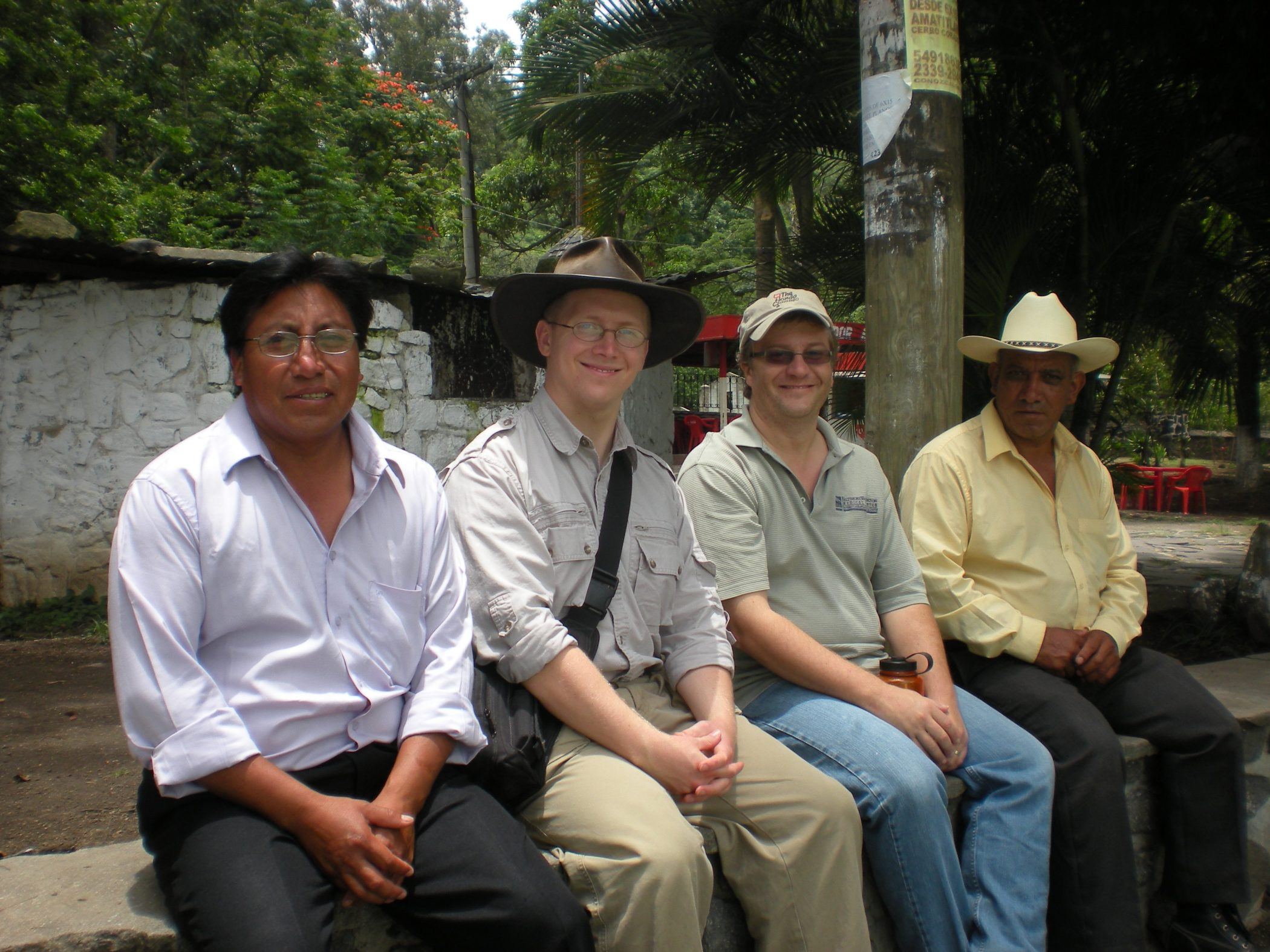 4 Men sitting on a wall connecting over evangelism