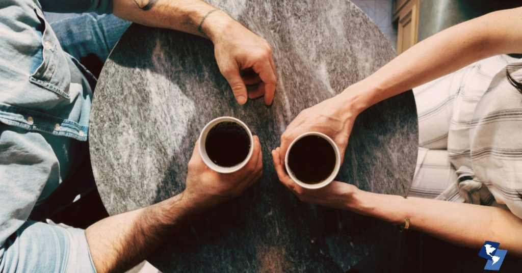 Man and Woman drinking coffee, making small talk