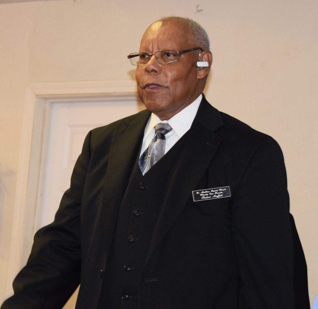 Ministry of Church Ushers: A level of formal dress for male church usher Coat, vest, and Tie with name badge.