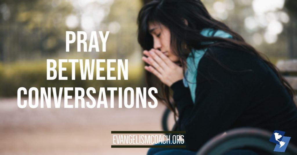 Girl sits on a bench, praying for her friends between those evangelism conversations