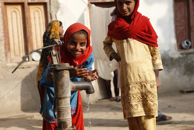 Source: Flickr, two children at a well, drawing water to satisfy thirst