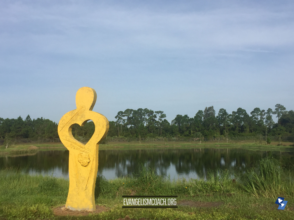 Statue Of Yellow Figure with Heart Removed