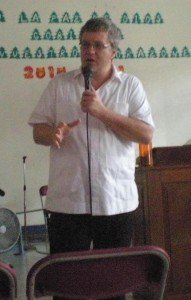 Rev. Chris Walker teaching in a local church